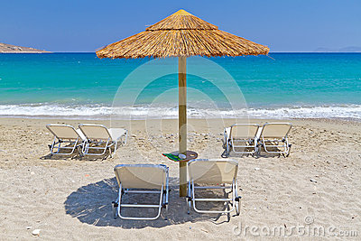 Deckchairs under parasol at Aegean Sea