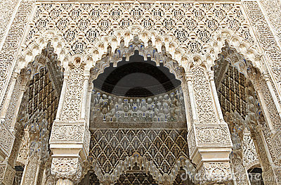 Decorated arches and columns inside the Alhambra