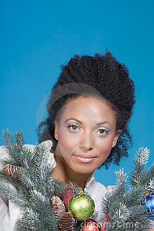 Decorated Christmas portrait of ethnic woman