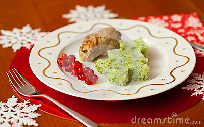 Decorated Christmas table with tasty veal and mash