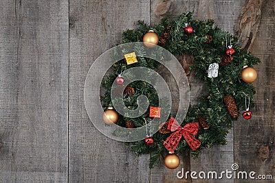 Decorated christmas wreath on barn board