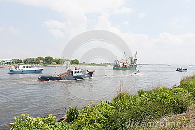 Decorated fishing ships leaving the harbor Editorial Stock Photo