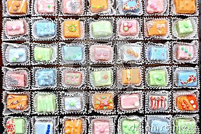 Decorated petit four cakes