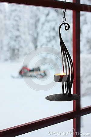 Free Decorative Candle  On Window And Snowmobile Stock Images - 27562164