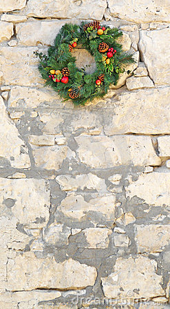 Decorative Christmas wreath on a vintage stone wall