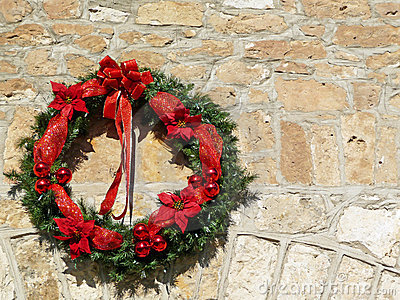 Decorative Christmas wreath on vintage stone wall