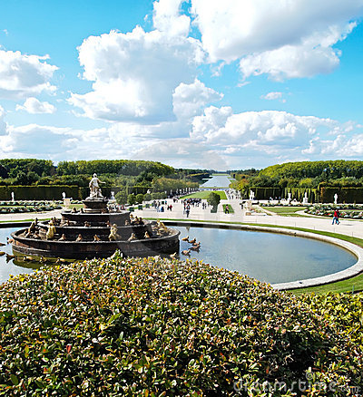 Decorative gardens & fountain with bright blue sky