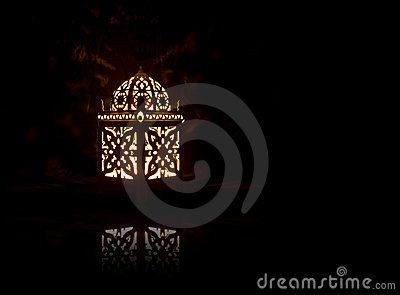 Decorative Lantern with Burning Candle on Black