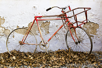 Decorative old bicycle against an old peeling wall