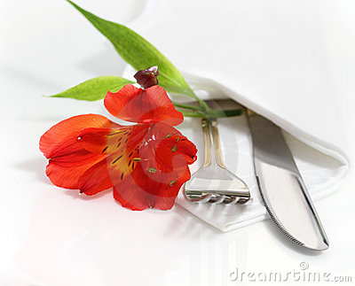 Decorative table setting with flower