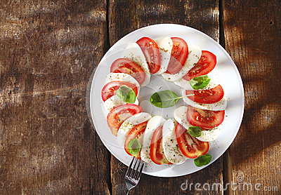 Decorative tomato and cheese salad