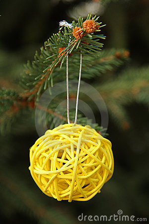 Decorative yellow ball on Christmas tree