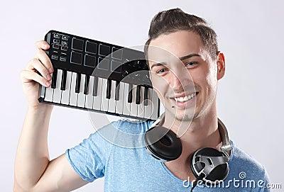 Deejay with headphones and midi keyboard