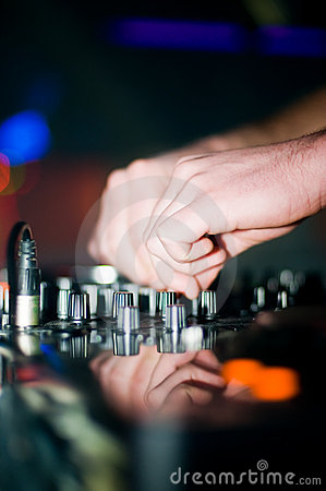Deejay s hand and turntable