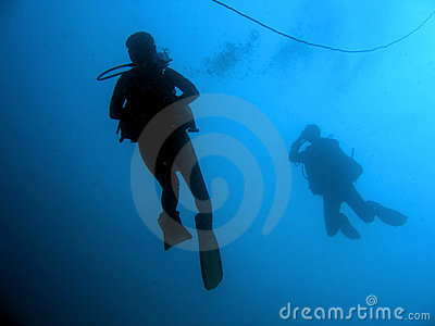 blue sea scuba divers silhouttes philippines