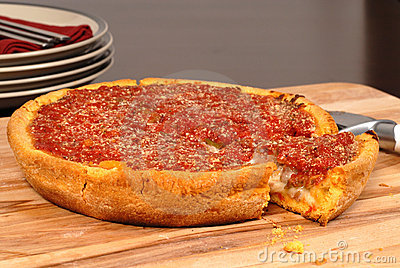 Deep dish pizza with a piece cut out