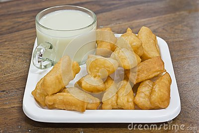 Deep fried dough sticks and a cup of soybean milk