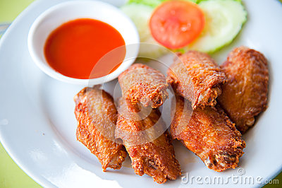 Deep fried spicy chicken wing with sauce