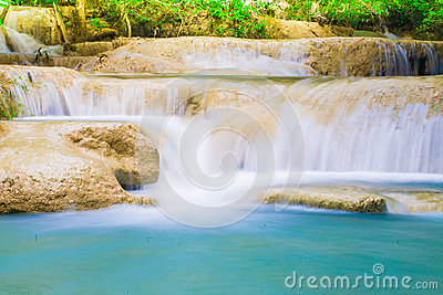 Deep jungle natural forest Waterfall in Thailand