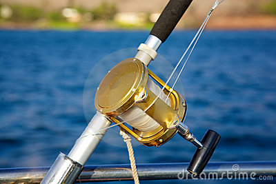 rod and reel for deep sea fishing from back of boat stock photo, Reel Combo