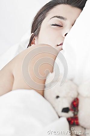 Deep sleep with a childish teddy bear