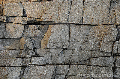 Deeply cracked granite surface texture