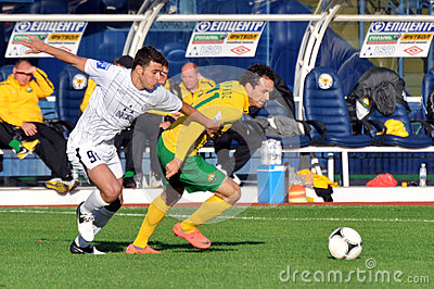 Defender and a striker running the ball Editorial Stock Photo