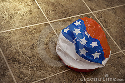 Deflated American flag toy ball