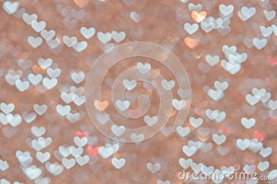 Defocused abstract hearts light background