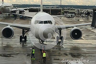 Delayed flight. Airplane arrived after rainstorm.