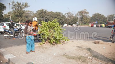 Delhi, India - November 28, 2018: The poor children of India dance and earn  money on the streets