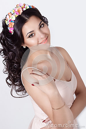 Free Delicate Elegant Beautiful Schaslivo Smiling Woman With Long Black Hair Curls With A Colored Rim Of The Colors In A Bright Dress Stock Photography - 53507602