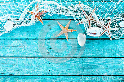 Delicate marine border of net, shells and starfish