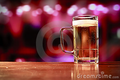Delicious beer mug on a bar
