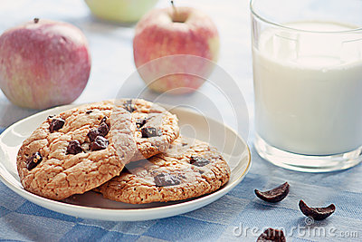 Delicious breakfast: milk, cookies and apples