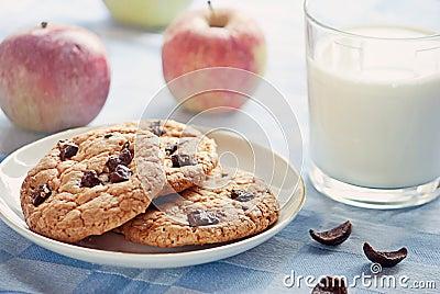 Delicious breakfast: milk, cookies and apples