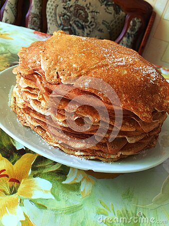 Pancakes. Delicious Breakfast, pancakes on a plate, in the village royalty free stock photography
