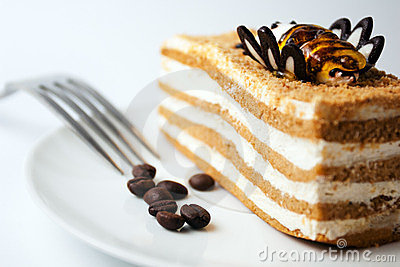 Delicious cake with coffee beans