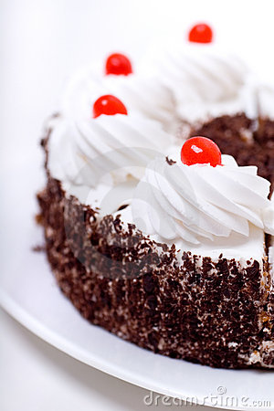 Delicious cake with whipped cream