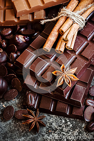 Free Delicious Chocolates And Spices On A Dark Background. Royalty Free Stock Images - 72802459