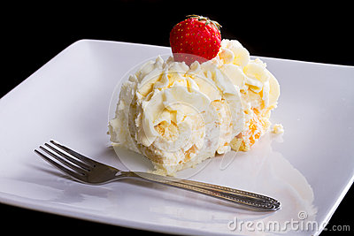 Delicious cream cake on the plate