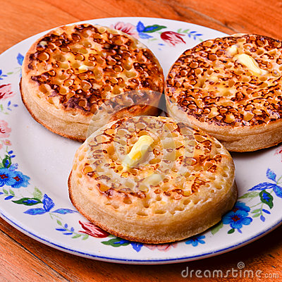Free Delicious Crumpets Covered In Melting Butter Stock Photo - 33988560