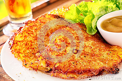 crunchy potato fritters or pancakes made from grated potatoes ...