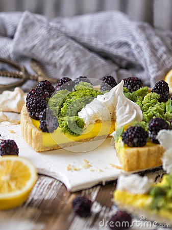 Free Delicious Homemade Lemon Tart. Pie On Rustic White Table. Tart With Blackberry And Meringue Royalty Free Stock Image - 91527736