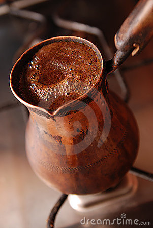 Delicious hot coffee made in turkish coffee-pot