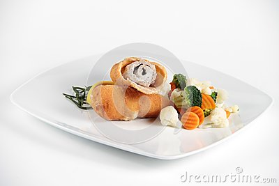 Delicious meat role with vegetables on a plate