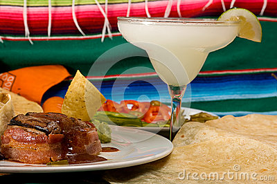 Delicious Mexican food with frozen Margarita drink