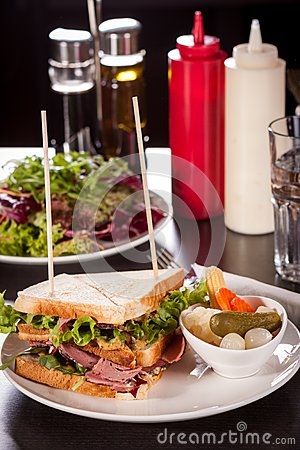 Free Delicious Pastrami Club Sandwich And Pickles Royalty Free Stock Image - 47536466