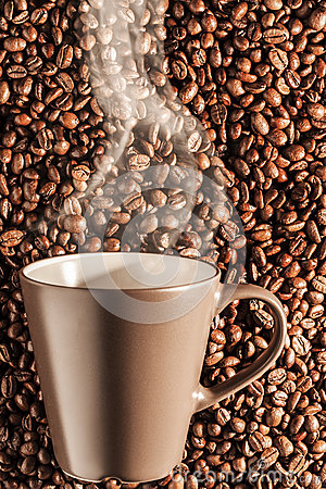 Delicious steaming hot coffee on beans 2