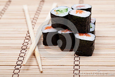 Delicious sushi on bamboo mat